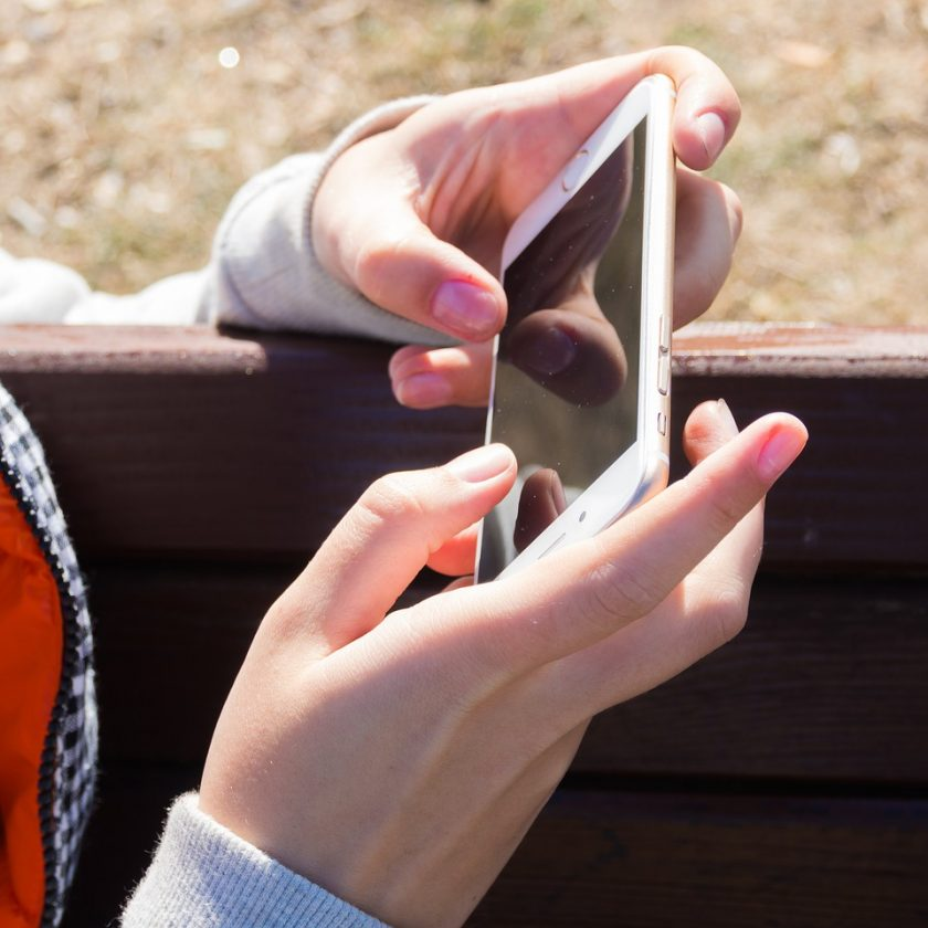 Iphone on her hand